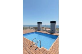 Новые апартаменты рядом с морем, в очень зеленом районе Барселоны