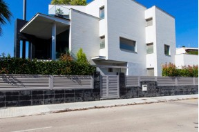 Modern designer house with an elevator on seafront in Vilanova i La Geltru